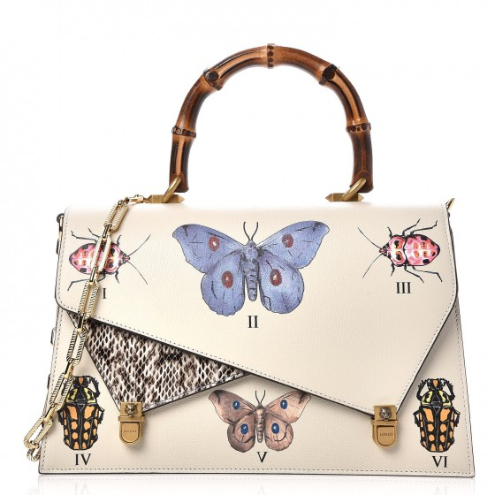 5ba276ee7d64 Speaking of Spring, how beautiful and season appropriate is this bag?! It  features butterflies and other little insects. It also has the popular  bamboo top ...